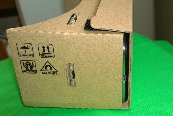 The back flap is adjustable, to 'fine tune' the exact distance of the smartphone screen from the lenses....