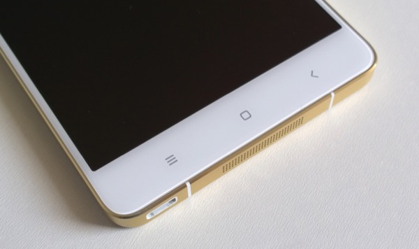 The bottom section of the Mi Note Pro - showing 'disguised' microUSB, speaker grille and capacitive controls...